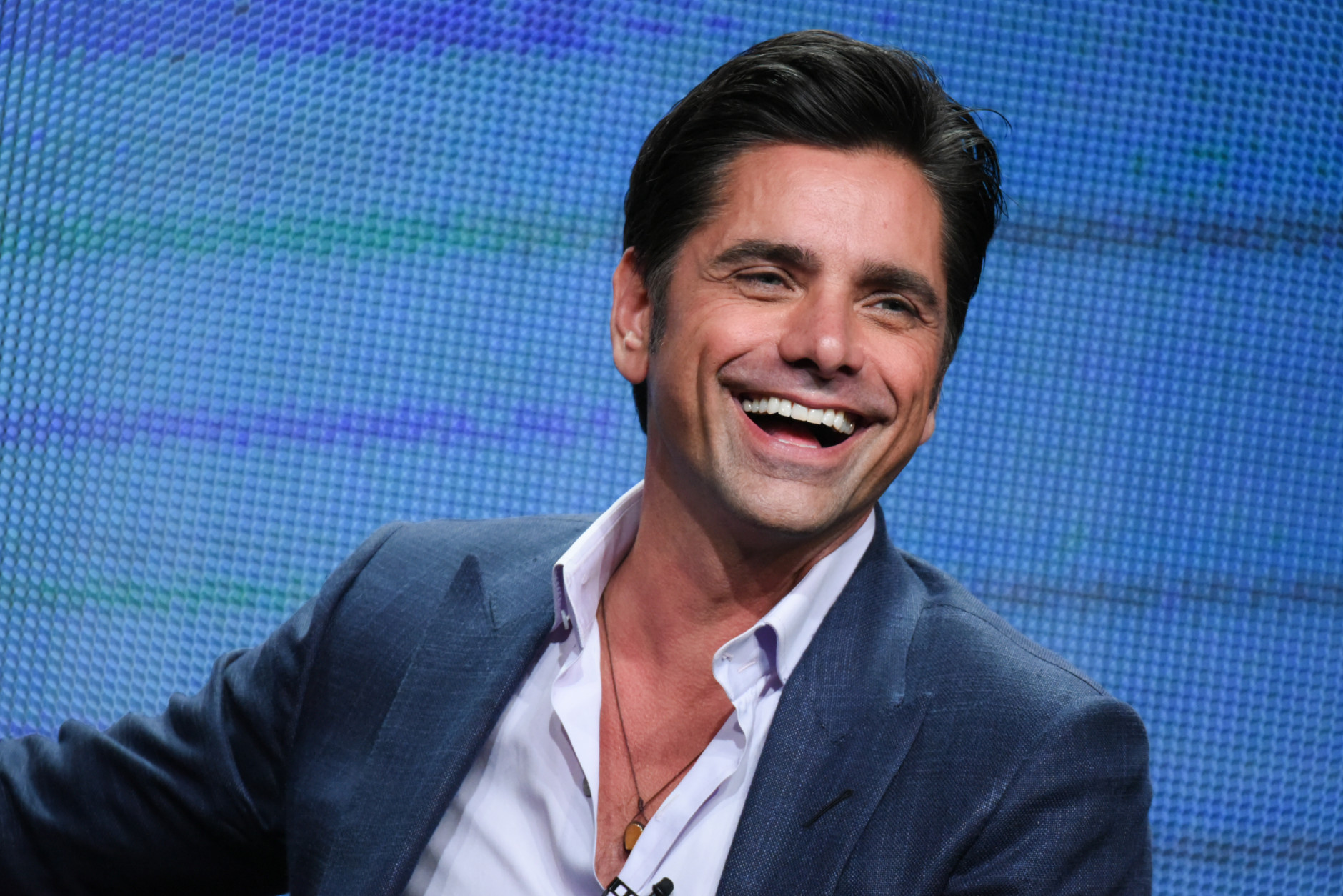"""John Stamos participates in """"Grandfathered"""" panel at the Fox Summer TCA Tour at the Beverly Hilton Hotel on Thursday, Aug. 6, 2015, in Beverly Hills, Calif. (Photo by Richard Shotwell/Invision/AP)"""