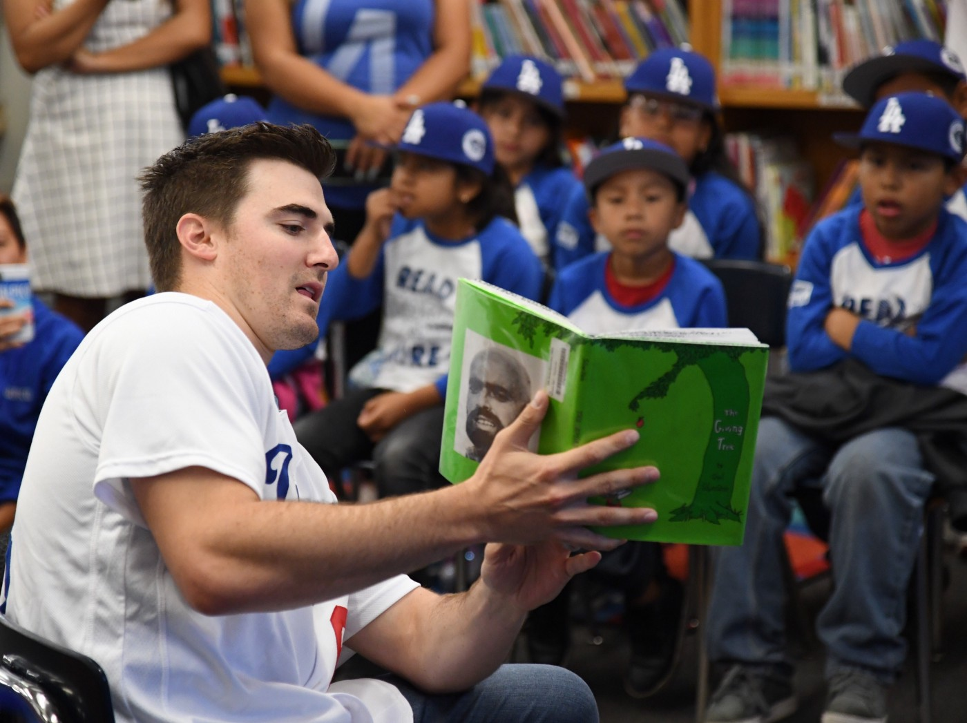 Ross Stripling reads to students at Tenth Street Elementary