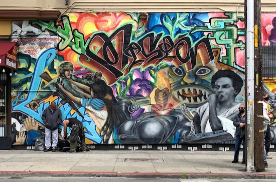 Photo of artist Spie's mural
